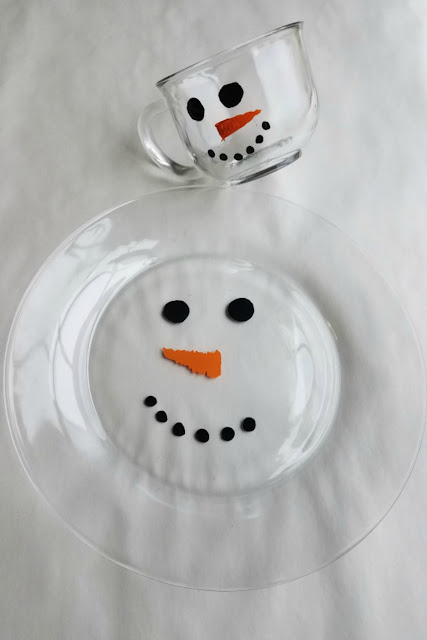 These simple snowman mugs and plates are a perfect winter DIY. They are cute, dishwasher safe and darling filled with white hot chocolate or cookies.