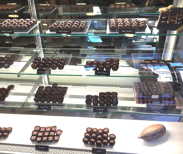 Chocolate truffles and bonbons displayed elegantly at Eclat Chocolate
