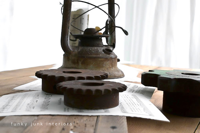 A rusty lantern and gear junk Christmas centrepiece - by Funky Junk Interiors