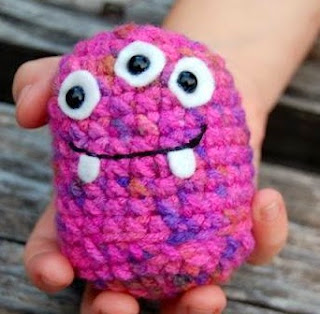 http://www.craftsy.com/pattern/crocheting/toy/purple-stitch-project-monster-amigurumi/18587