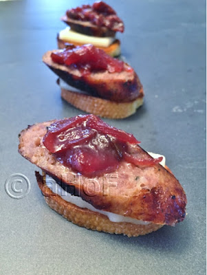 Sausage and Cheese Crostini with Cherry Onion Relish