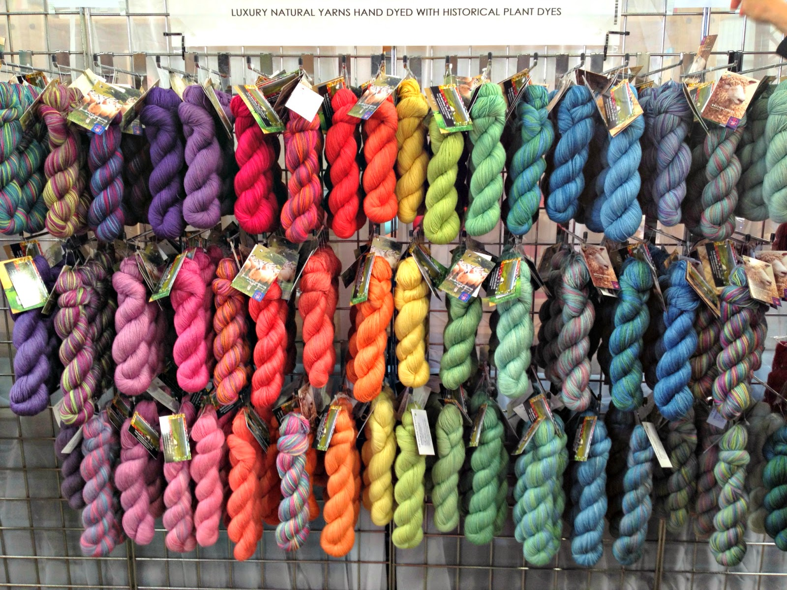 the natural dye studio - a wall of colourful wool silk yarn