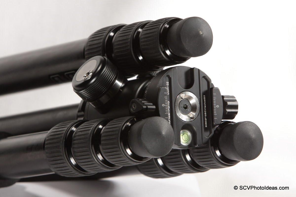 Sunwayfoto DDH-02 between Triopo GT-3228X8C folded legs - front