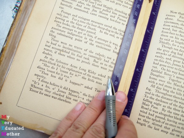 A ruler makes it easier to figure out what part of the book to hollow out.