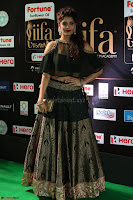 Ritika Singh in a Ethnic Deep Neck Dark Green Choli Ghagra at IIFA Utsavam Awards March 2017 ~ 025.JPG
