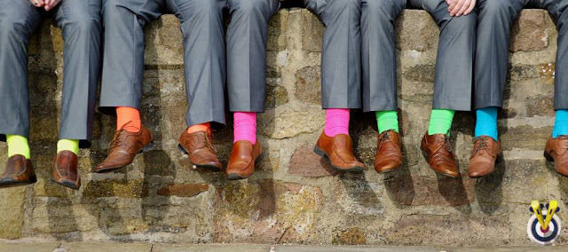 Best Man & Ushers Sat On A Wall with bright socks on