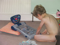 naked boy playing pinball