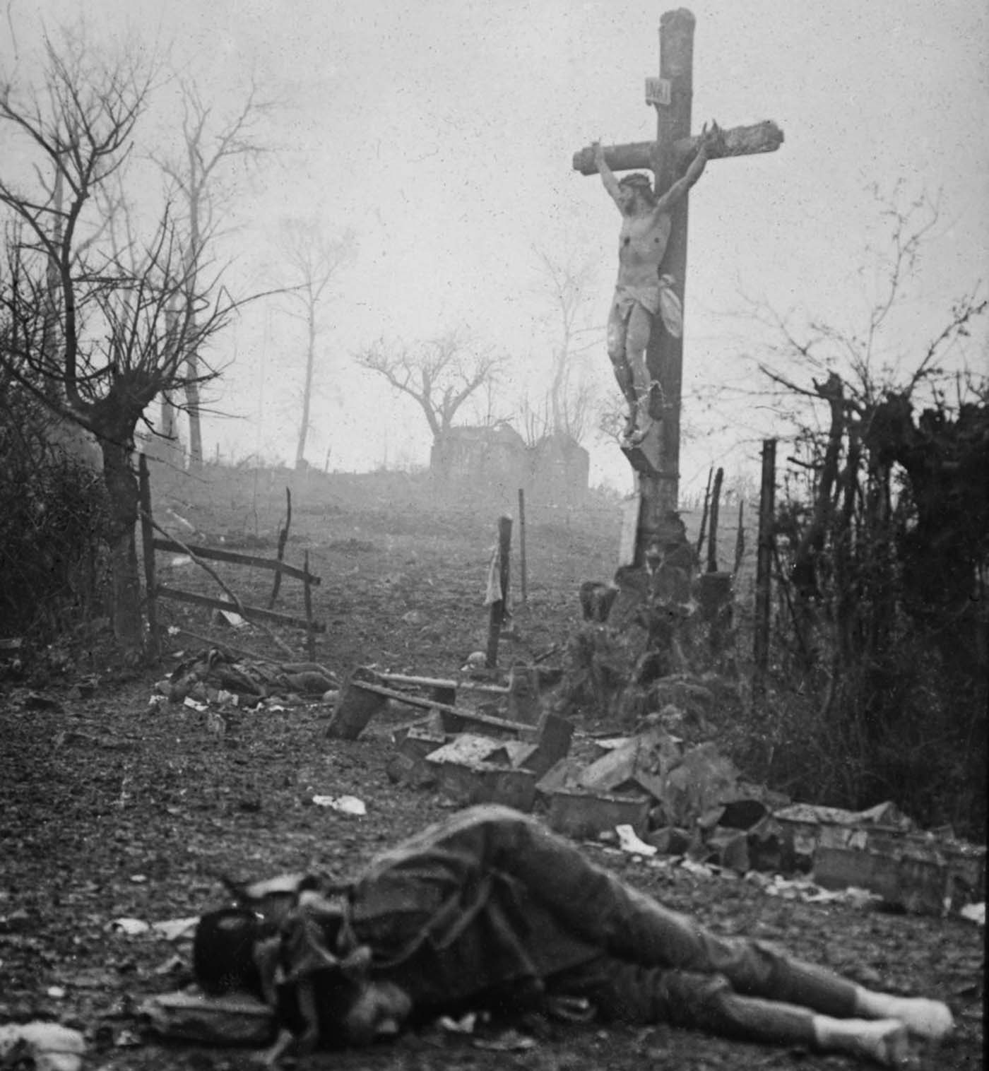 Carnage: Amid the appalling devastation and bodies of dead soldiers, a crucifix stands tall - miraculously preserved from the shell fire. The powerful image was captured after a bloody skirmish in 1917.