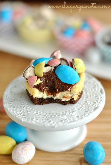 Malt Ball Mini Cheesecakes + Easter Candy Dessert Roundup the perfect way to enjoy your pastel Easter Candy from the Easter Egg Hunt. You will love these Easter Candy Dessert Recipes on www.Embellishmints.com