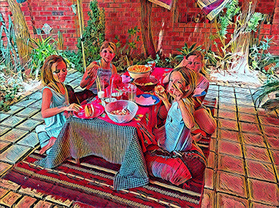 Prisma filter photo: Jasmine party - girls sitting at table on ground