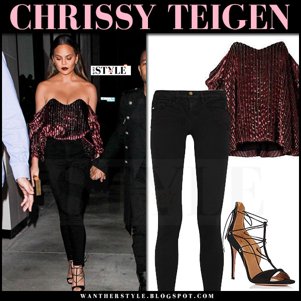 Crissy Teigen in burgundy velvet off shoulder caroline constas top and black jeans frame denim what she wore