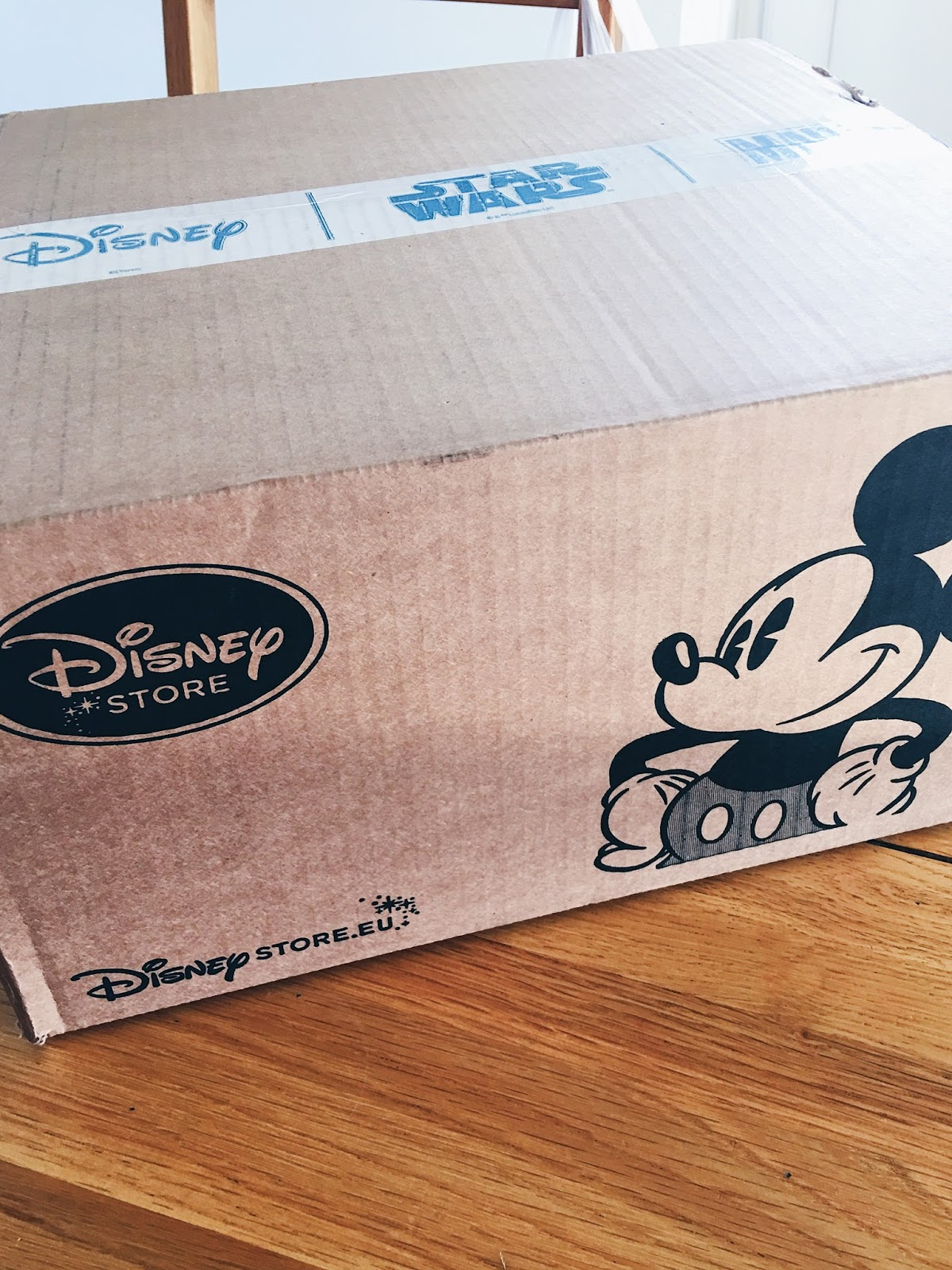 Disney Store Shipping Cardboard Box on Wooden Table