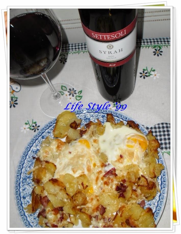 piatto tirolese con speck, uova, formaggio e patate