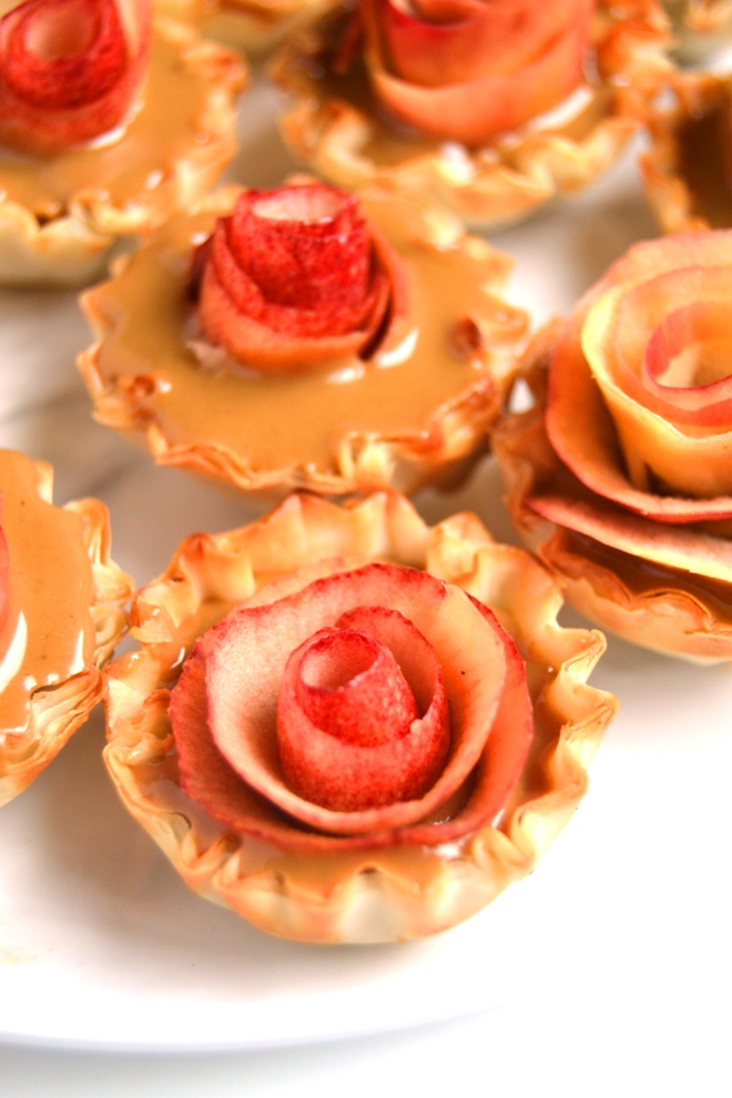 3-Ingredient Apple Rose Tarts are super simple to make and look impressive- no one will know how easy they were! Filled with warm, drippy peanut butter, fresh apples all in a crispy mini phyllo cup! www.nutritionistreviews.com