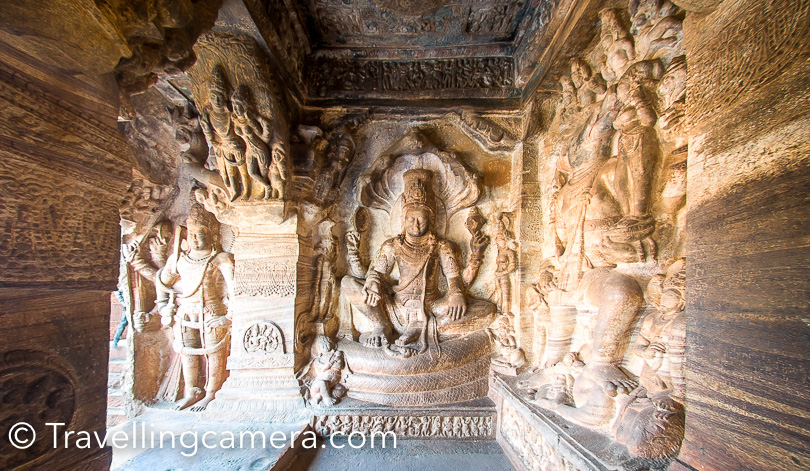 As you enter into these caves at Badami, you would notice these beautifully carved statues. Badami Caves 1 to 4 are on a hill in soft Badami sandstone  formation. In Cave 1, among various sculptures of Hindu divinities and themes, a prominent carving is of the Tandava Shiva  as Nataraja. The very first photograph of this post is clicked outside the first cave in Badami. Above photograph shows Vishnu in cave-3 at Badami.