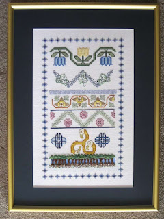 framed embroidery sampler with cross-stitch, blackwork and drawn thread techniques
