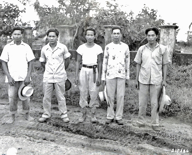 Men who survived being thrown into a deep well by the Japanese in 1945.  Image source:  United States National Archives.