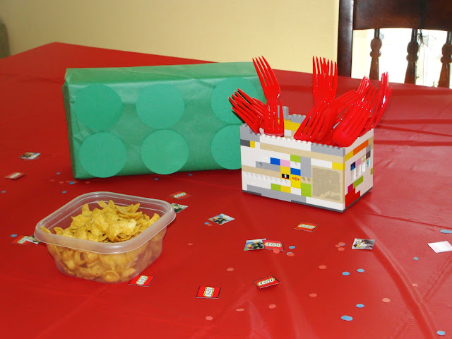 Create a silverware holder by building a lego box.  You can also roll up napkins and place them in there too.