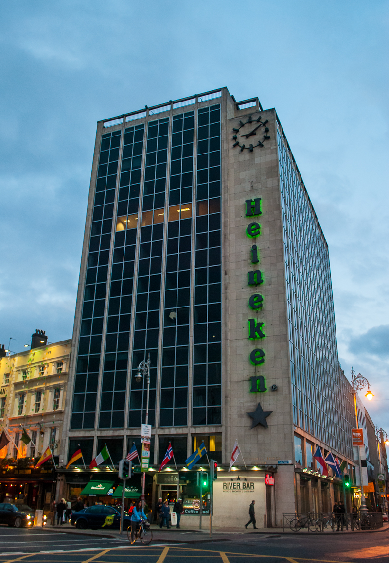 Image of the Heineken Building with its words lighted up
