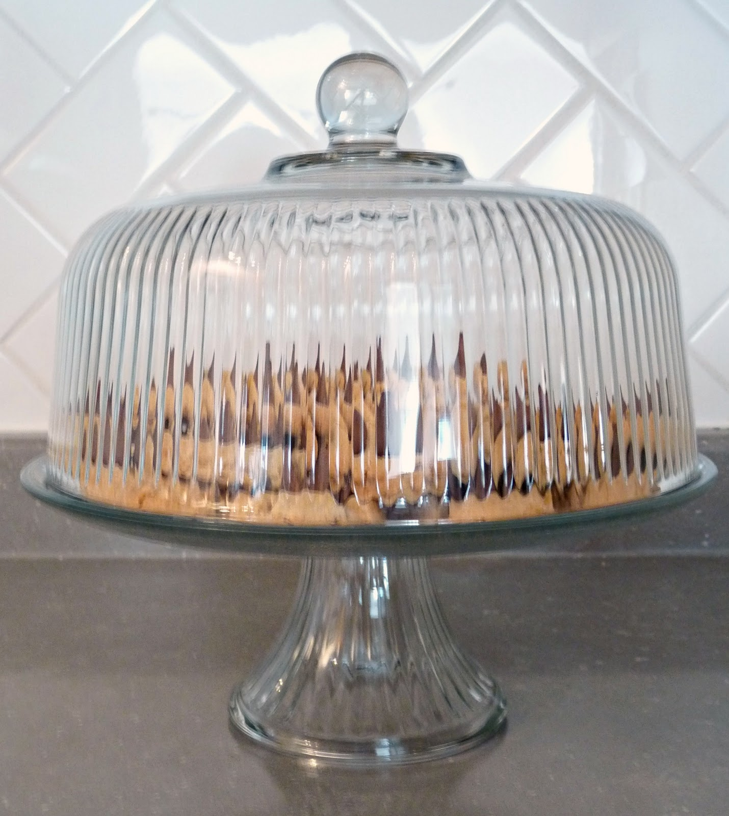 Glass cake stand full of cookies