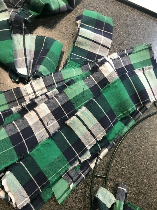 strips of green plaid pajama pants