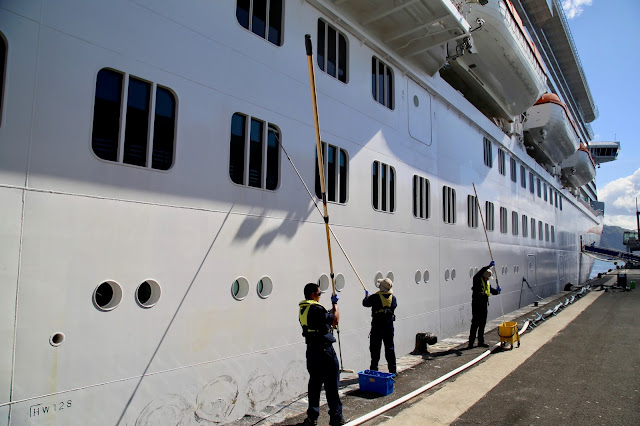 Painting the ship when it's docked.  Britannia, P and O cruise ship. pic: Kerstin Rodgers/msmarmitelover