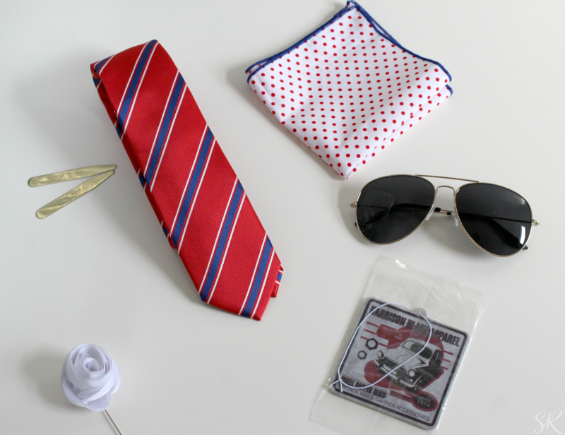 a tie, handkerchief, aviator sunglasses and accesories