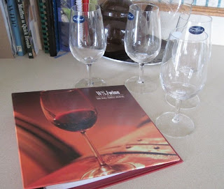 wine book and tasting glasses