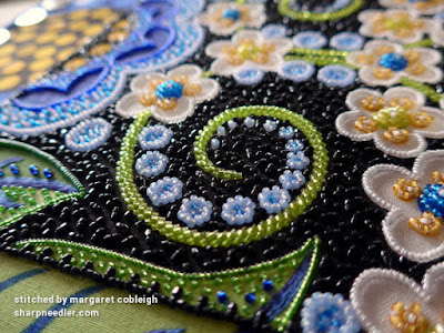 Part of the black beaded background waiting to be couched. (Wild Child Japanese Bead Embroidery by Mary Alice Sinton)