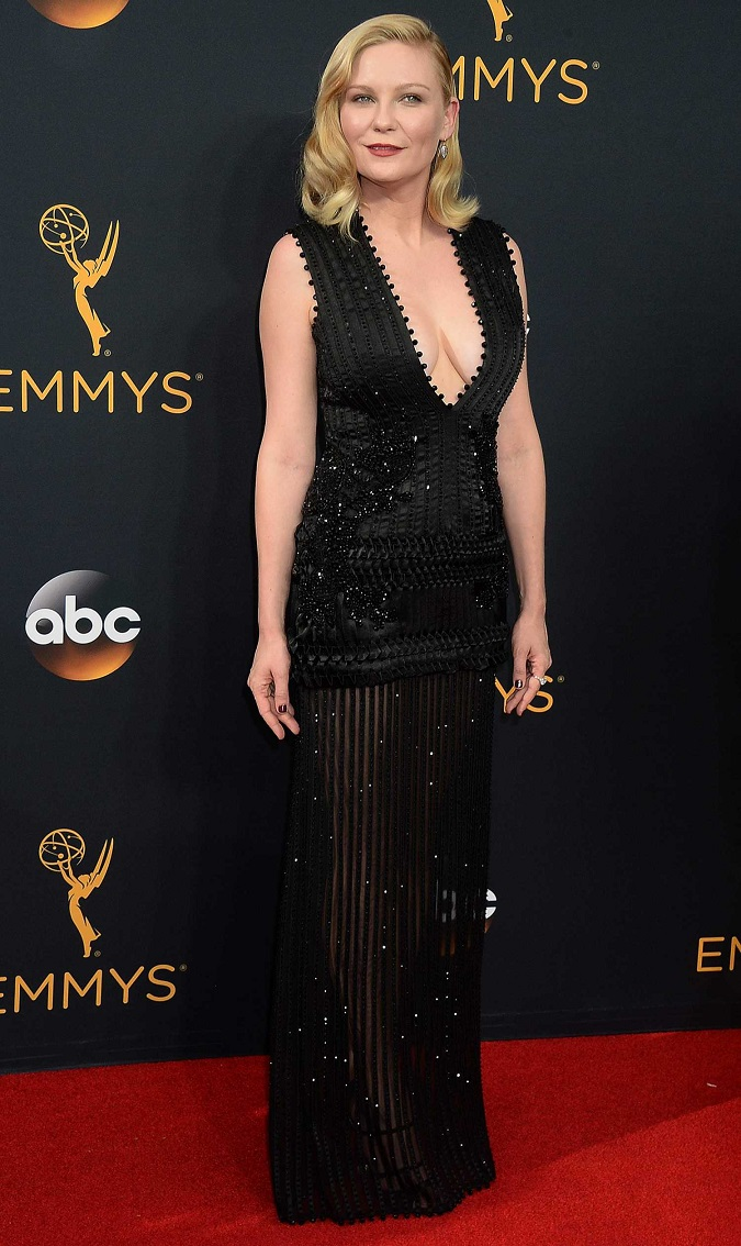 Kristen Dunst dazzles in a low cut dress at the 2016 Emmy Awards