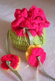 http://www.ravelry.com/patterns/library/mini-flower-gift-pouch