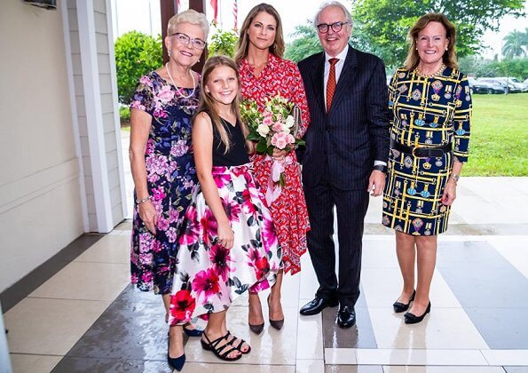 Princess Madeleine wore a new asymmetric paisley-print silk dress by Veronica Beard, and Ebba Brahe earrings. Leonore, Nicolas and Adrienne