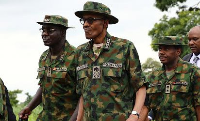 President Buhari in military camouflage