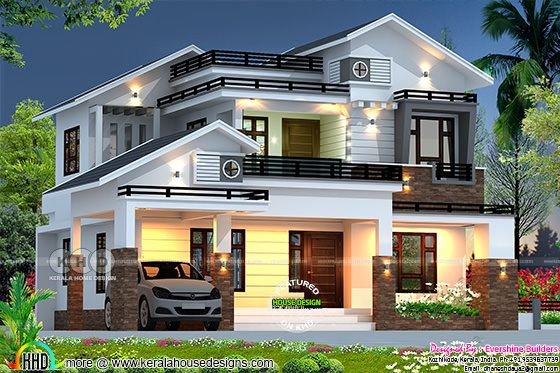 mixed roof 4 bedroom house with lights on
