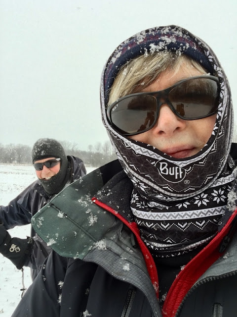 selfie of woman and man in cross-country ski wear on the ski trail