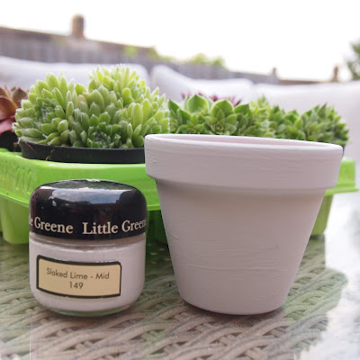 Paint your pots with spare paint you might have, we used Little Greene slaked lime
