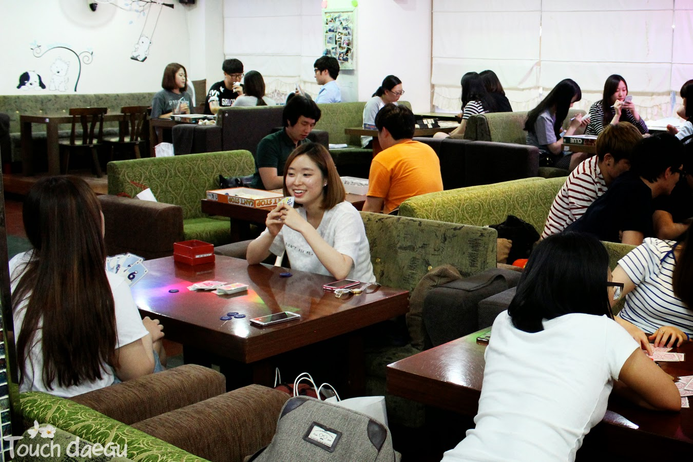 People are enjoying the card game in the cafe