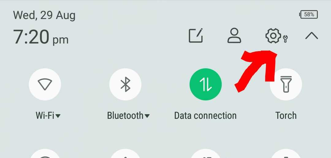 The settings icon on your device's notifications tray.