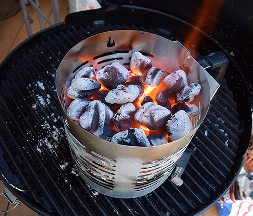 Hot coals smoking in Char-Broil Half -Time Chimney Starter