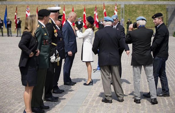 Princess Marie of Denmark participates In Internation Peacekeepers Day at The Citadel. Marie wears Paule Ka White Two-Tone Belted Coat, By Malene Birger Paxlow Pump