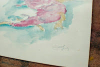 Close up photo of Kostas Gogas traditional-like watercolor drawing of a light red dragon. Click to enlarge.