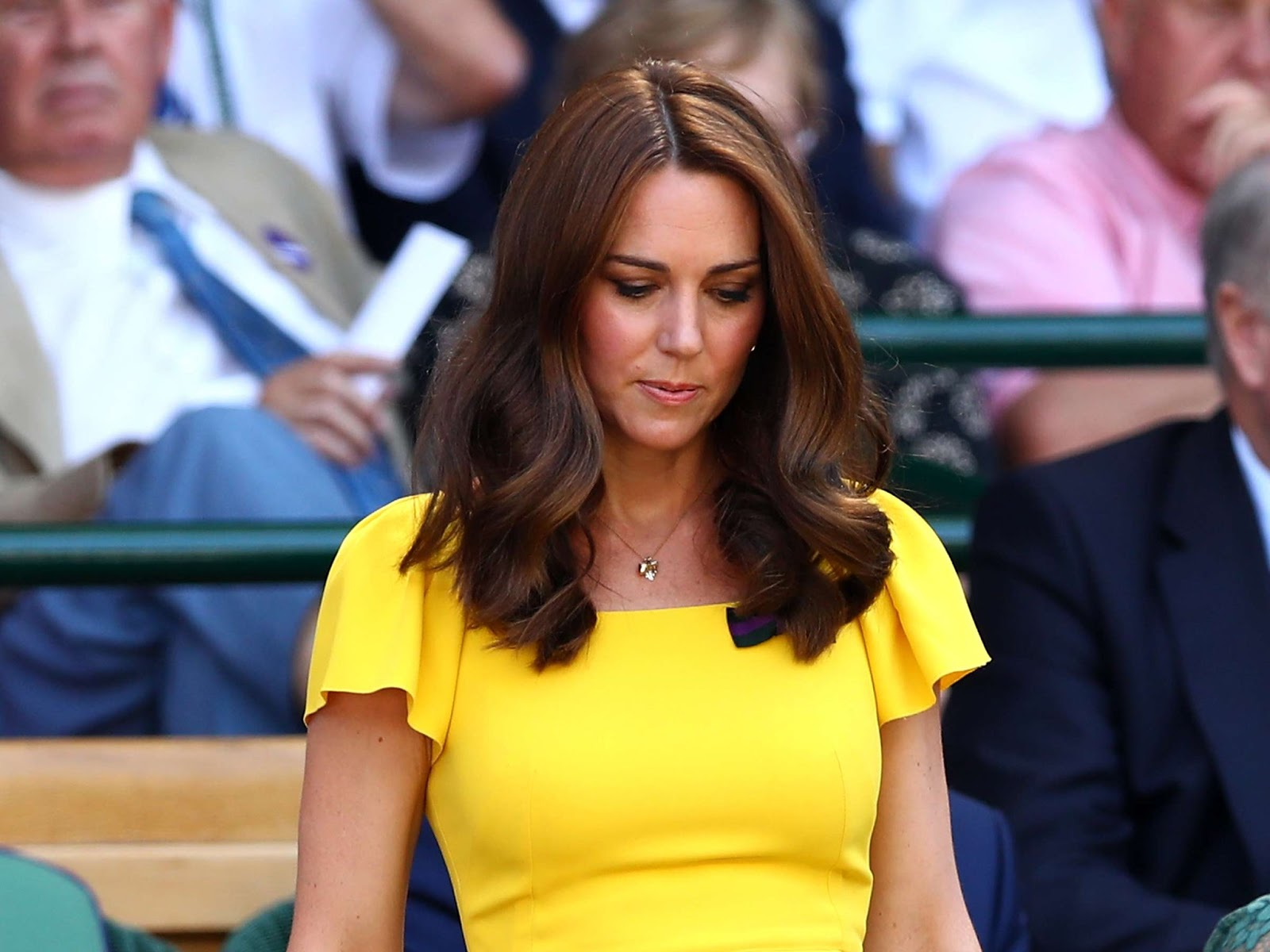 The Duchess of Cambridge dazzled in a designer frock as she joined Prince William for a star-studded men's final at Wimbledon.