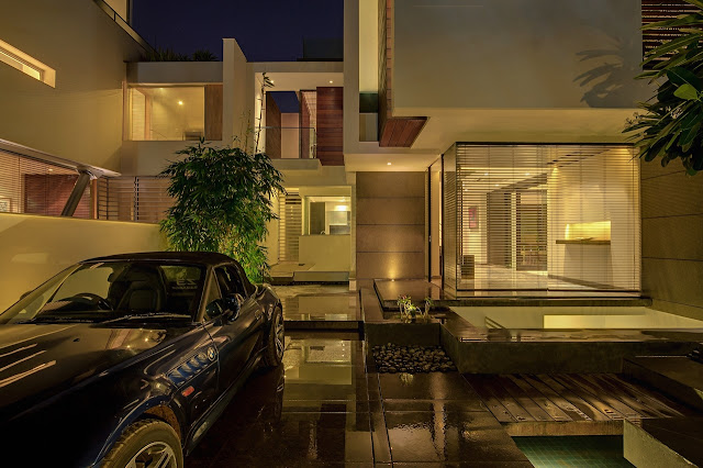 Picture of modern home and the car from the driveway