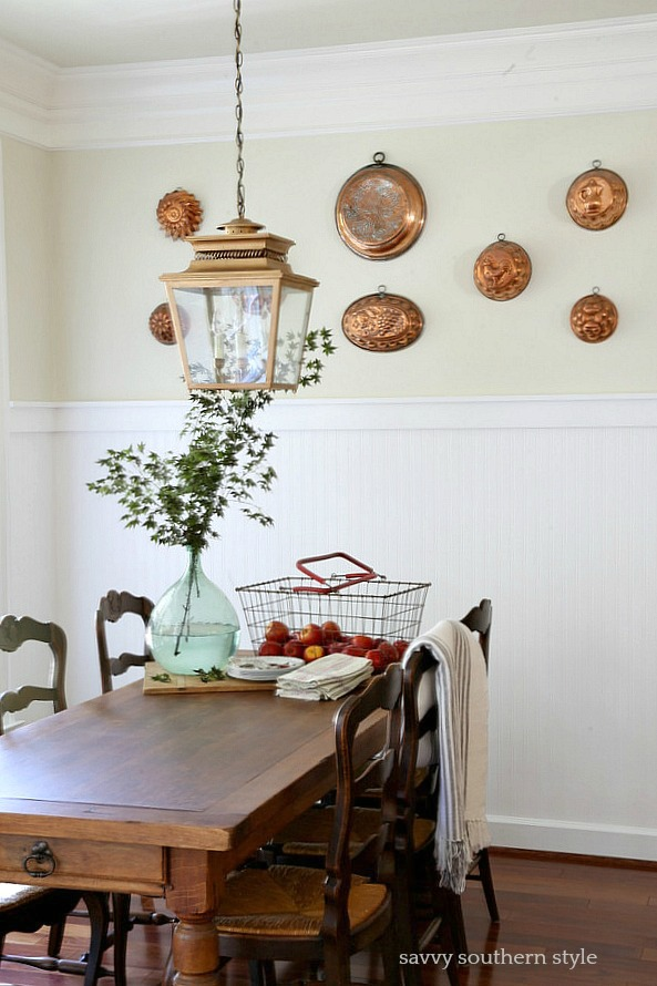 copper molds on breakfast room wall