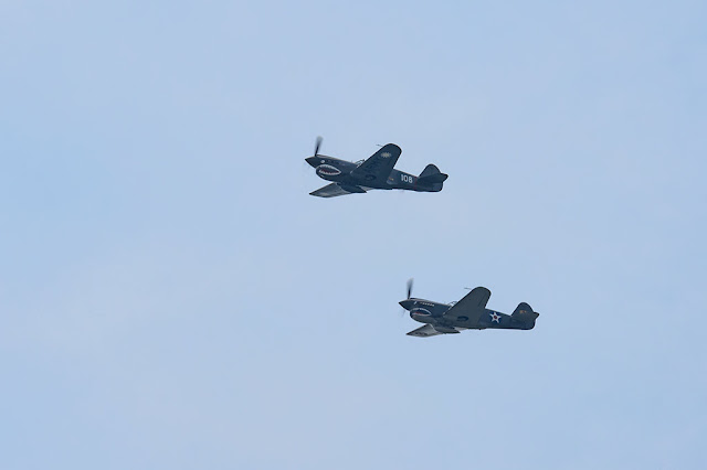Two Curtiss P-40 Warhawks flying over Washington, DC