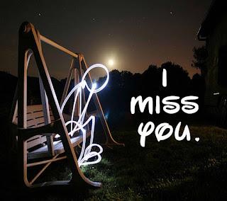 sad lights man sitting on jhoola with i miss you photo