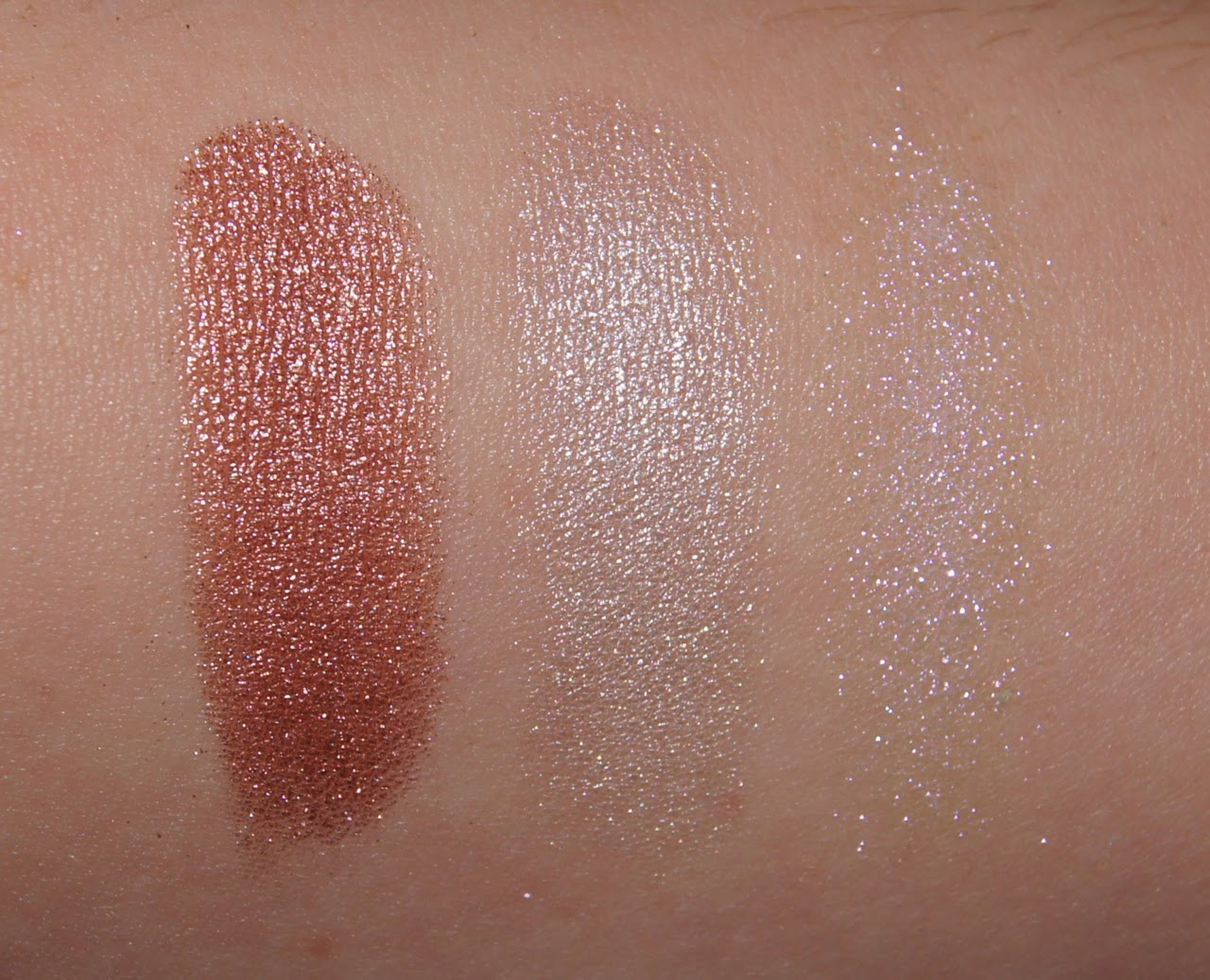 swatches mac tan pigment, loreal infallible pressed pigment time resist white illamasqua static pigment