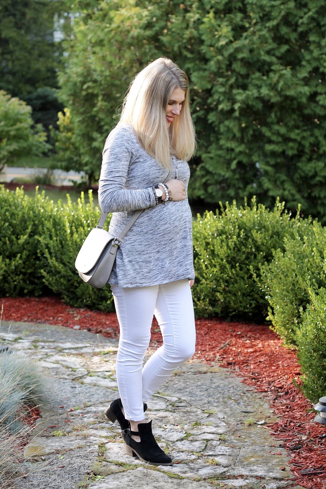 grey henley tunic, white jeans, black booties, grey saddlebag, fall maternity outfit