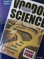 Voodoo Science, by Robert Park, superimposed on Intermediate Physics for Medicine and Biology.