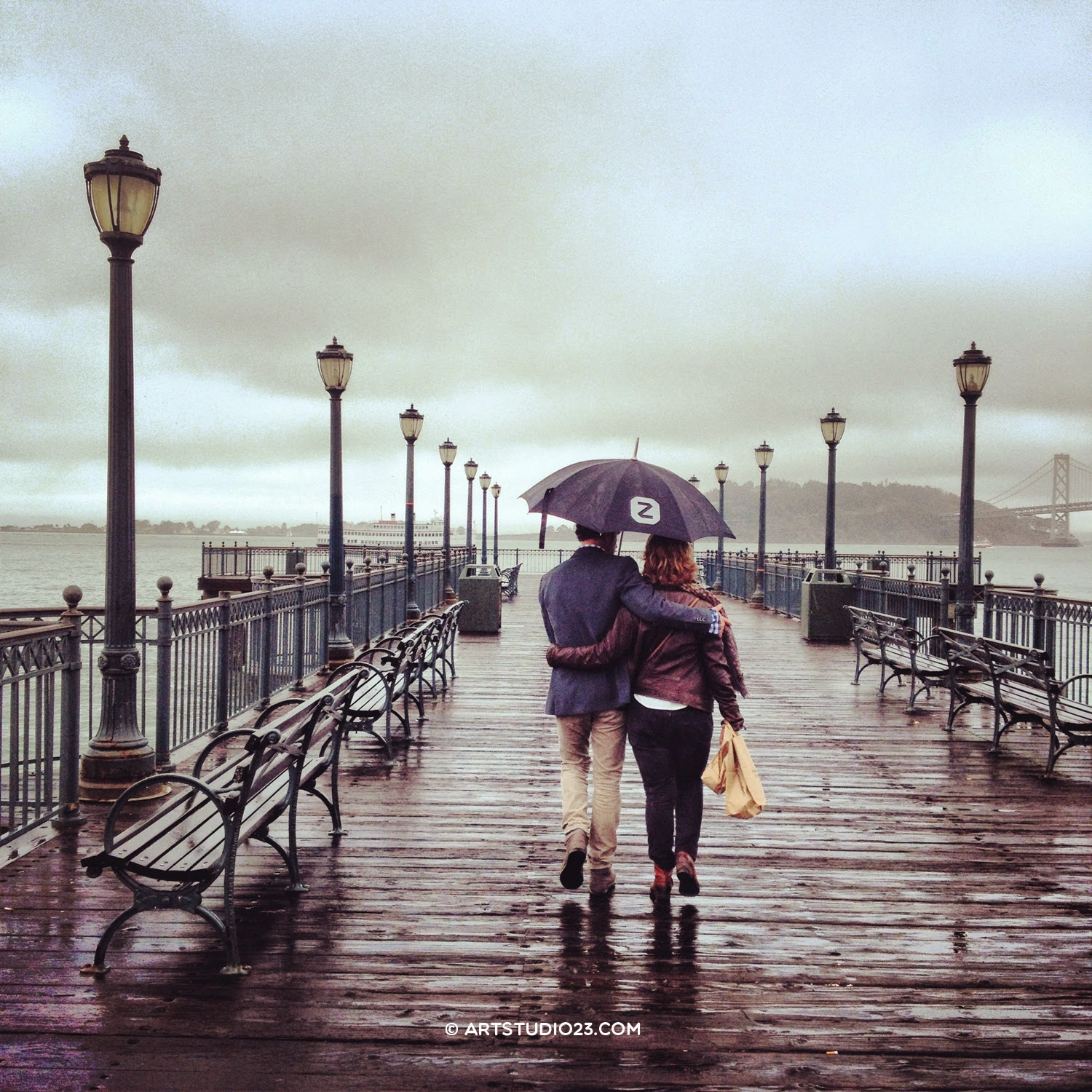 Couple with umbrella at the pier